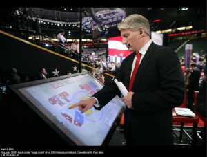This is a photograph of John King using CNN's touch screen 'magic board' at the 2008 Republican National Convention in St. Paul, Minnesota.