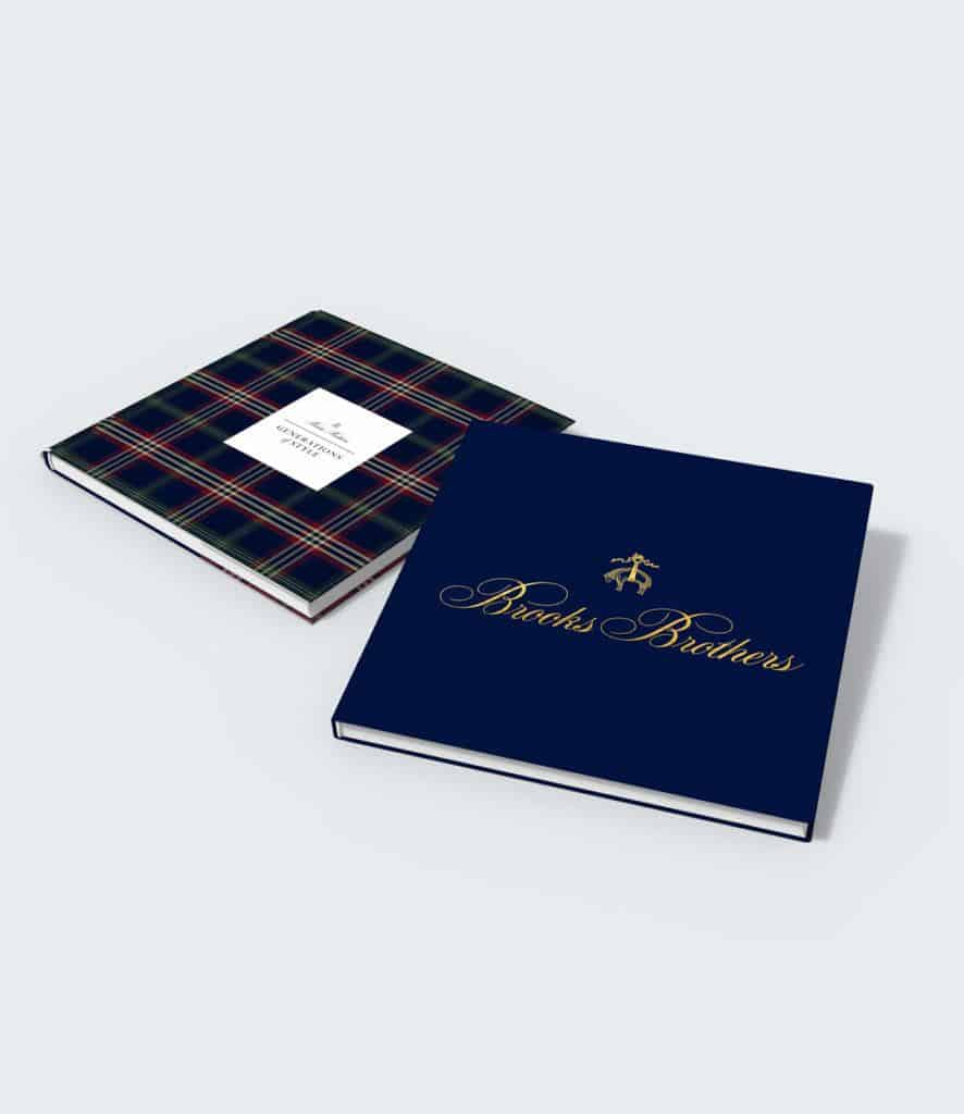 This is a photograph of Brooks Brothers' custom history book, which they created to commemorate a major milestone.